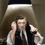 Man using two telephones — Stock Photo #12302734