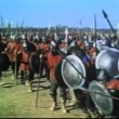 Wide shot medieval bow and arrow warfare on battlefield — Stock Video