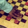 Stock Video: Close-up of hands playing checkers