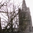 Stock Video: Panning from church steeple to busy village street
