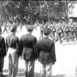 Parade of American soldiers marching as crowd watches — Vídeo de stock