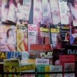 Panning rows of adult magazines — Stock Video #26625773