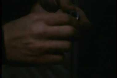 Close-up of hands setting timer on home-made bomb — Stock Video
