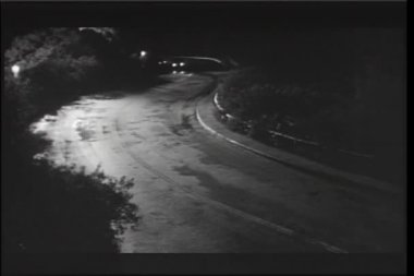 Cars driving down country road at night — Stock Video