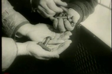 Close-up of hands counting pieces of hardware — Stock Video