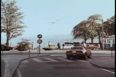 Wide angle view cars driving along street in Switzerland — Stock Video