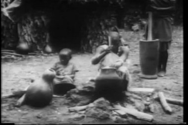 Montage African villagers weaving and cooking — Stock Video