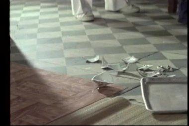 Medium shot of hands picking up fragments of broken ceramic ware — Stock Video