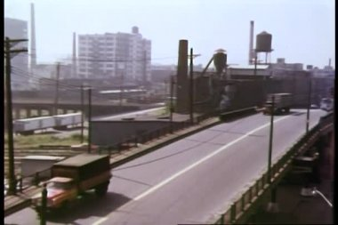 Cars and trucks crossing bridge — Stock Video