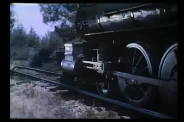 Locomotive wheels traveling down railroad track — Stock Video