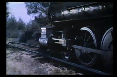Locomotive wheels traveling down railroad track — Stock Video