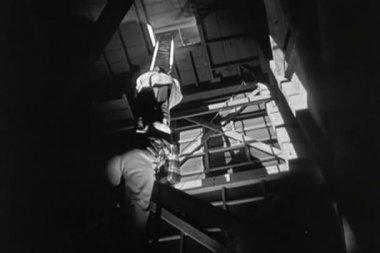 Two men climbing up shaky ladder — Stock Video