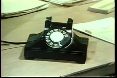 Man holding small notebook talking on rotary phone — Stock Video