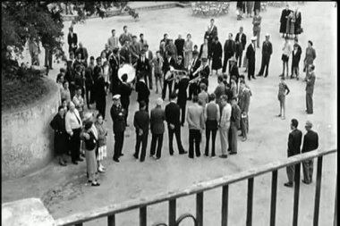 High angle view of crowd gathering in street to listen to band — Stock Video