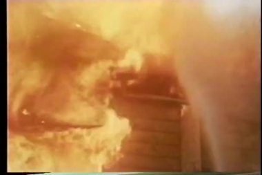 Firemen hosing down burning house — Stock Video