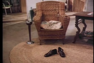 Zoom in to men's shoes on rug — Vídeo de Stock