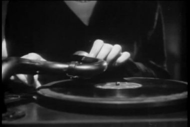 Close-up of hands placing needle on record, 1940s — Stock Video