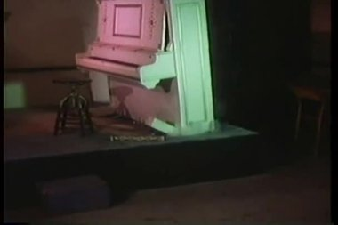 Floating piano exploding and sinking into floor — Vídeo Stock