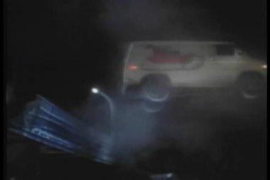Van breaking through fence and flying towards full moon — Stock Video