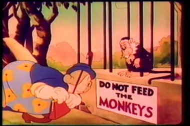Cartoon of a caged monkey reprimanding woman for feeding him — Stock Video