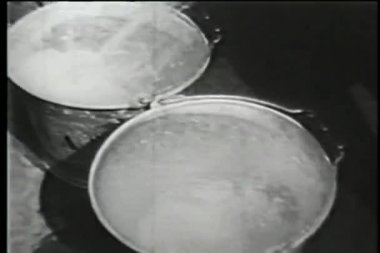 Filling buckets with water using hose, New York City, 1930s — Stock Video