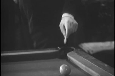 Woman retrieving note dropped in billiard pocket — Stock Video