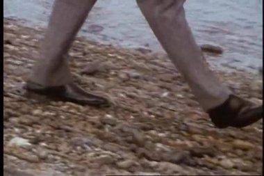 Close-up of legs walking on beach — Stock Video