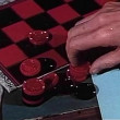 Close-up of male hand stacking checkers — Vidéo