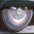 Close-up of a rotating wheel of 1950s car — Stock Video