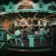 Wide shot of merry-go-round at night — Stockvideo
