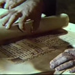 Close-up of hands unrolling scroll — Stock Video