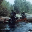 Two policemen on motor bikes crossing brook — Stock Video #26644573