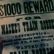 Stock Video: Close-up of reward flyer for capture of train robber