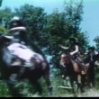 Stock Video: Barbarians on horseback charging through field