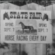 Zoom in shot of horse race poster on wooden fence — Stock Video