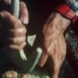 Close-up of hands tenderizing meat for pemmican — Stok video