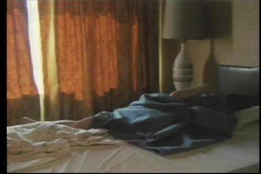 Man sleeping on bed in hotel room — Stock Video