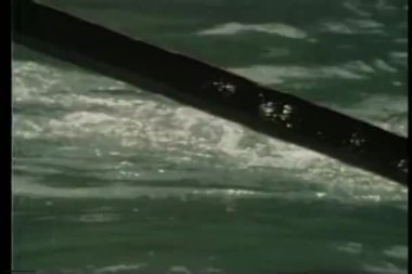 Close-up of oar slicing through water — Stock Video