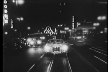 Vintage car driving on cable car tracks at night — Stock Video