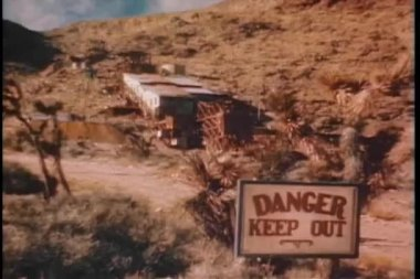 Wide shot of Danger Keep Out Sign near mine — Stock Video
