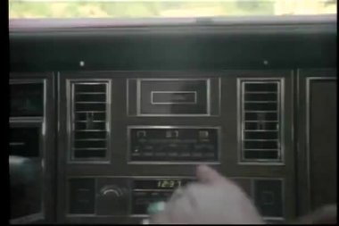 Close-up of male hand tuning car radio — Stock Video