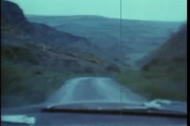 Point of view shot of car driving on twisting mountain road — Stock Video