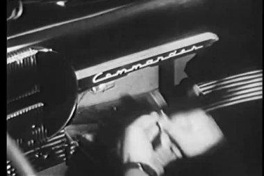 Close-up of man hiding gun in glove compartment of Studebacker Commander — Stock Video