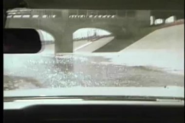 Point of view through car interior of water splashing on windshield — Stock Video