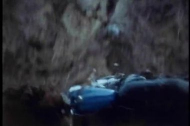Motor bike falling off side of cliff into ditch — Stock Video