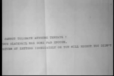 Close-up of typewritten blackmail letter — Stock Video