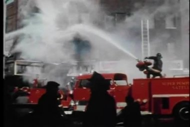 Firemen hosing burning building — Stock Video