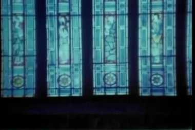 Pan up stained glass window in church — Stock Video