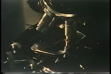 Close-up of hand rotating 1970s microscope — Stock Video