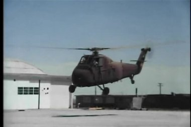 Military helicopter taking off from helipad — Stock Video